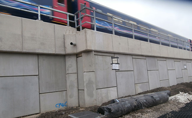 The reinforced soil retaining wall with live traffic above.