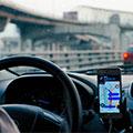 Photo of safe driver using navigation app.