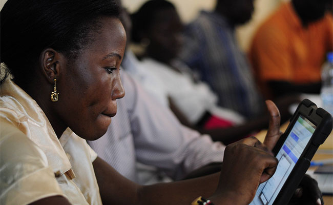 Woman in Juba completes training on mobile surveying tool using a tablet