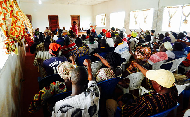 Community members in Liberia participate in a workshop to discuss improvements to local justice strengthening