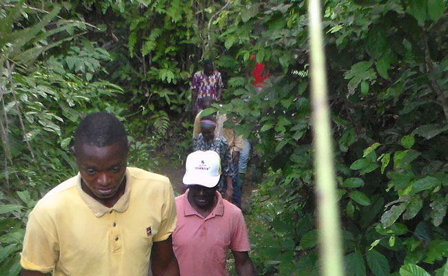 A group from ISF Cameroun and Mbondandick villagers visit the source of the community's water supply.