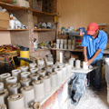 A Mexican member of the Caminos de Agua staff team prepares ceramic water filters.
