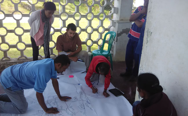 Facilitating a community mapping exercise to define Ossu's key community facilities and existing water supply systems