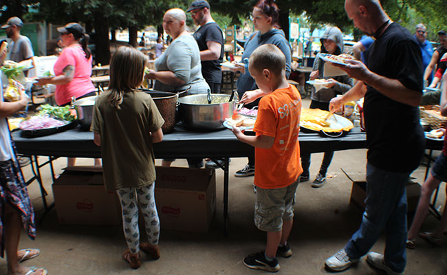 After grabbing their backpacks and school supplies, families enjoyed BBQ provided by Tetra Tech.