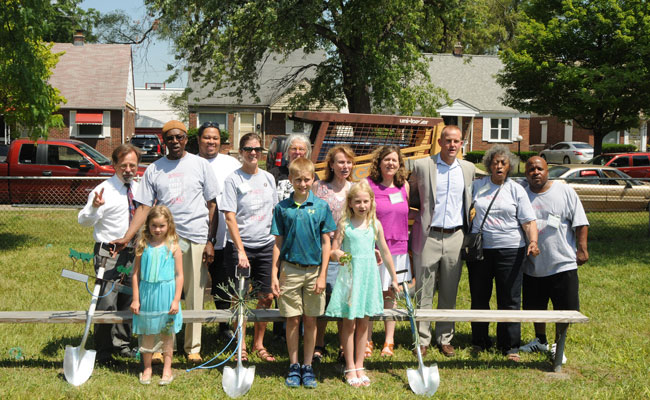 Members of the Viola Liuzzo Park Association with Viola's descendants pose with ceremonial art shovels at the park.