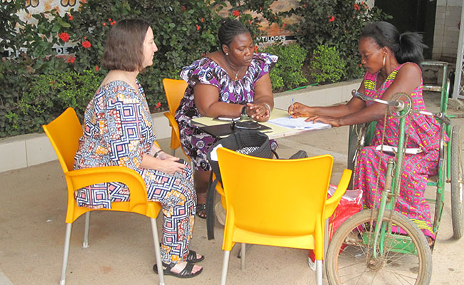 Tetra Tech Technical Director and ProJustice Handicap Manager meet with a representative of a disabled women's group.