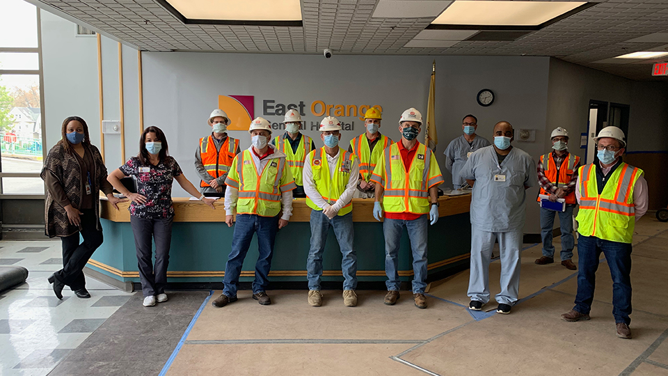 Tetra Tech and our partners review progress at the East Orange General Hospital COVID-19 project.