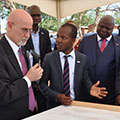 The U.S. Ambassador and Malawi President review Tetra Tech's design.