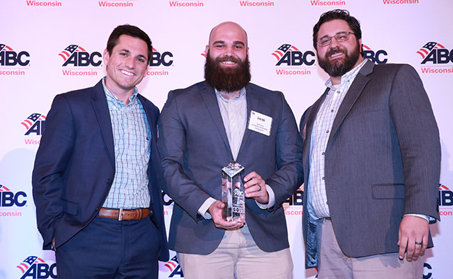 Tetra Tech's Lee Daigle joins team members from Joe Daniels Construction to receive ABC Wisconsin's 2019 Project Distinc