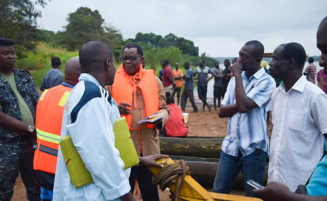 WA-BiCC staff discussing reliance issues with members of a coastal community in Cote d'Ivoire